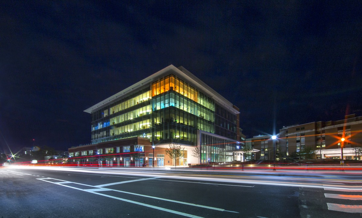 Exterior of a colorfully light multi story building at dusk