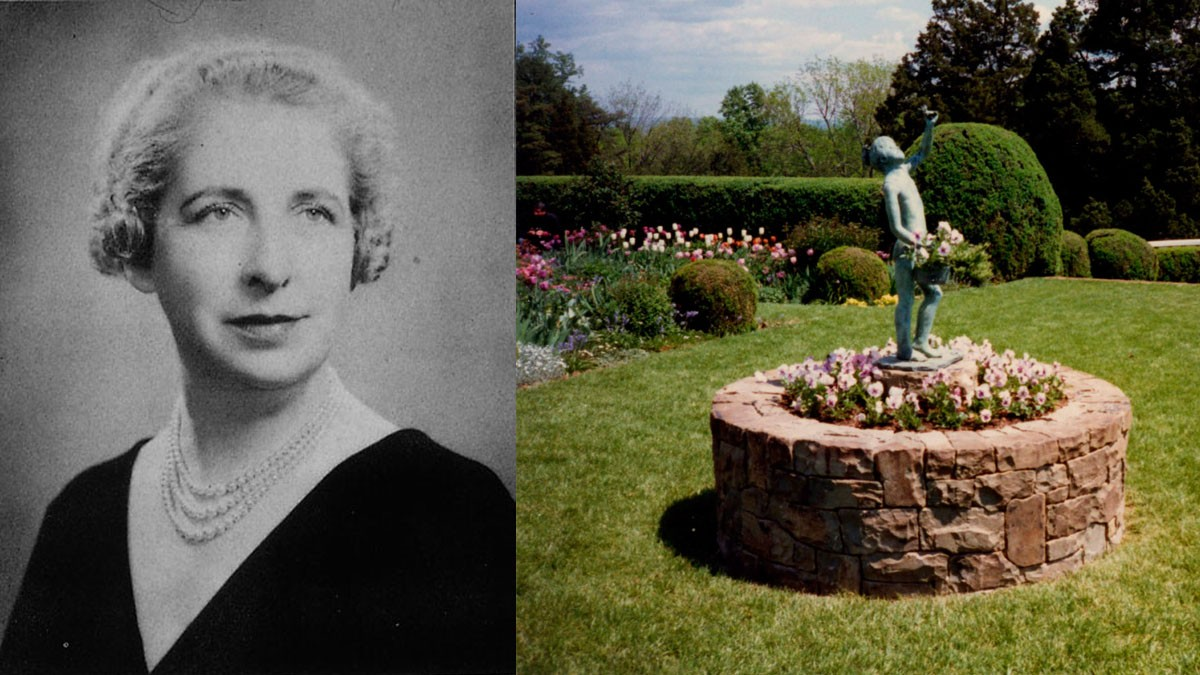 Black and white photo of woman and garden statue
