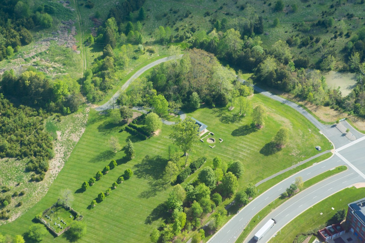 aerial view of an historic picnic pavilion surrounded by green lawn and trees