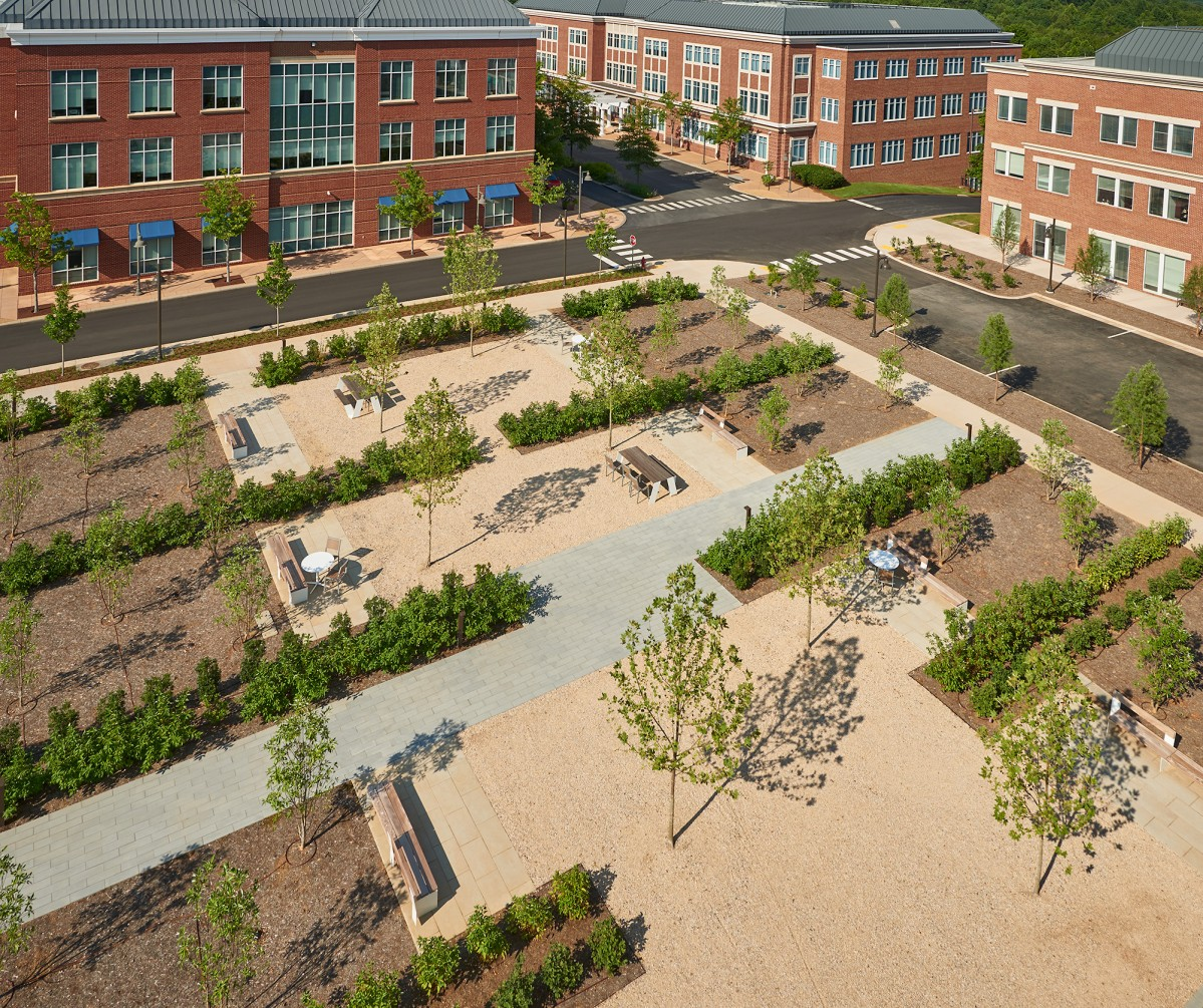 Aerial view of outdoor plaza with picnic tables and landscaping